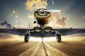 Printed kitchen splashbacks Airplane historical aircraft on a runway against a sunset