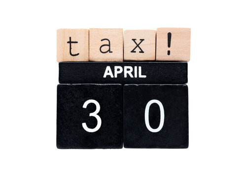 Tax return deadline for individual tax returns in Canada.  Light brown and black wood blocks with letters: Tax! April 30. Isolated on white.