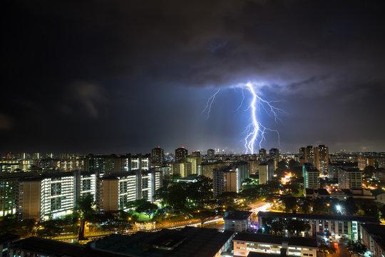 LIGHTNING OVER singapore city AT NIGHT