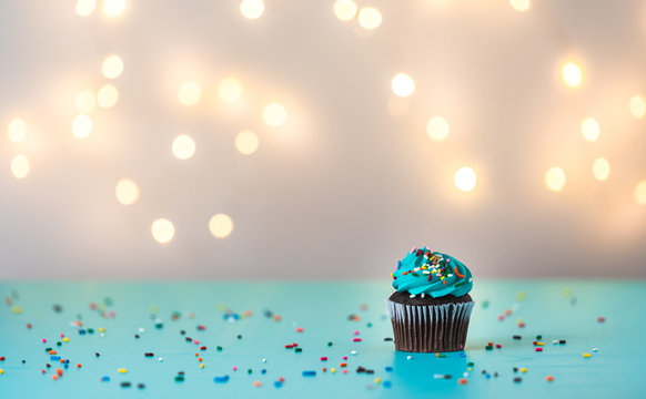 blue frosting happy birthday cupcake with candle