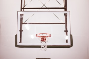 Basketball net on the basketball court with white walls