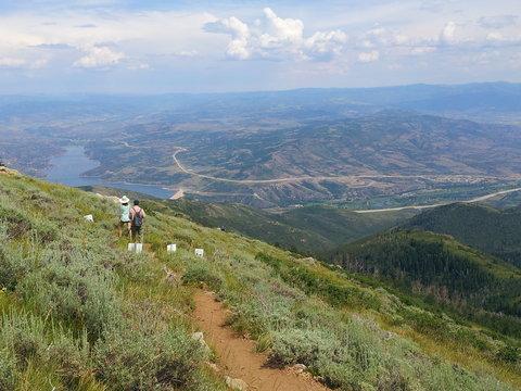Hikers enjoy a view of Jordanelle reservoir at Deer Valley Resort near Park City, Utah.