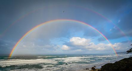 Beautiful double rainbow over the ocean off the oregon coast
