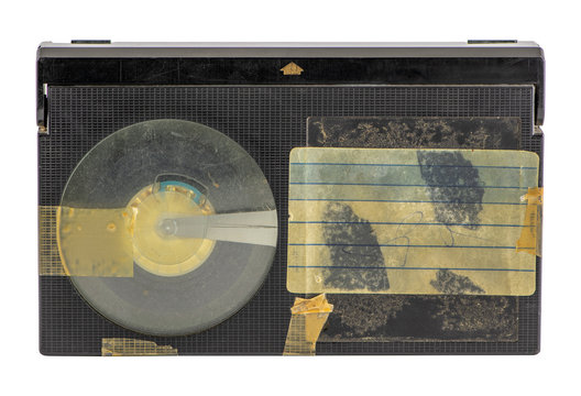 Old betamax video cassette isolated on white background. Vintage video technology. Blank, weathered sticker.