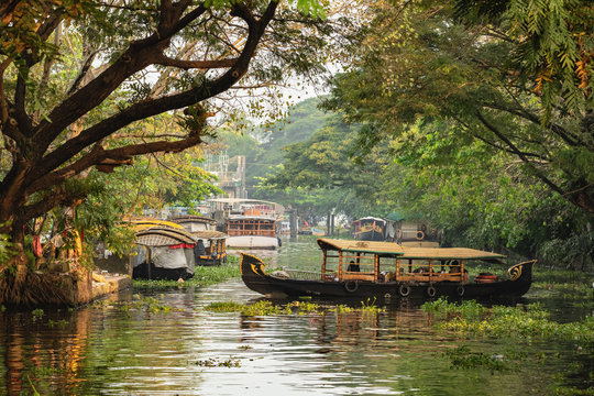 Beautiful Kerala backwaters landscape with traditional houseboats at sunset