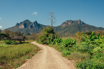Foto op Plexiglas Blauwe jeans Rural landscape with country road in Northern Thailand
