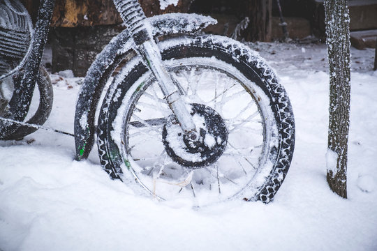 Cropped Motorcycle Parked On Snow