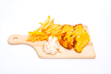 A picture of cheesy chicken breast set with fries and coleslaw insight