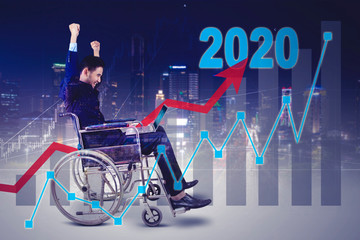 Businessman on wheelchair with financial chart