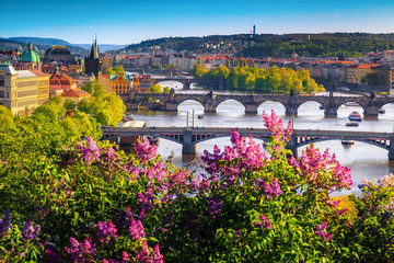Wonderful spring panorama of Prague with river and bridges