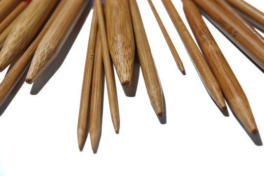 circular knitting needles from bamboo on a white background.