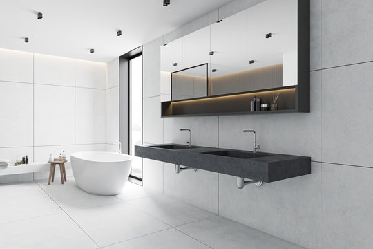 White tile bathroom corner, tub and sink