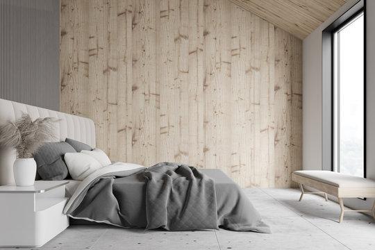 Wooden and gray attic bedroom interior