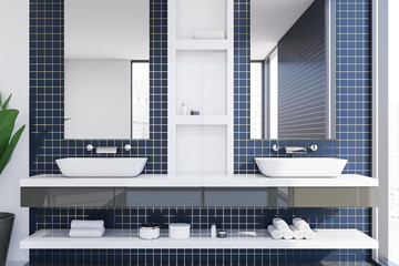 Blue tile bathroom interior with double sink