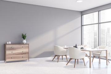Light gray dining room corner with cabinet