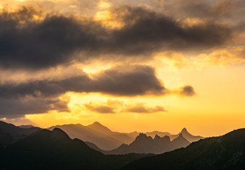Fotobehang Canarische Eilanden Amazing view of mountain peaks with beautiful clouds on the sunset. Location: Tenerife, Canary Islands, Spain. Travel concept. Artistic picture. Beauty world.