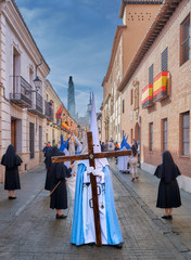 Christian religious procession through the streets with flags on the balconies