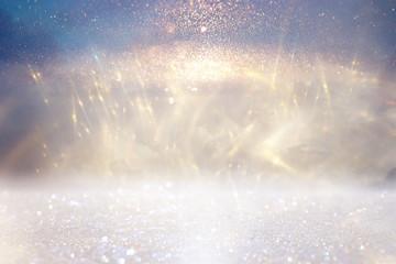 glitter vintage lights background. gold, silver, blue and white. de-focused