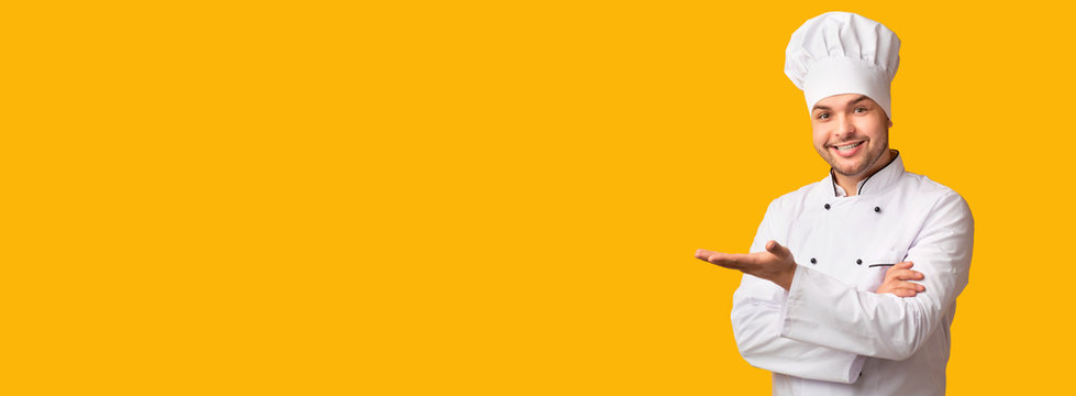 Cook Man Gesturing Showing Something Standing Over Yellow Background, Panorama