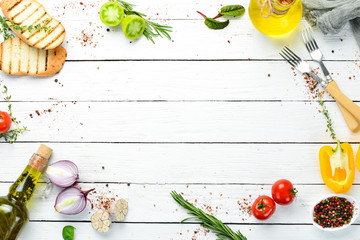 Fotomurales - White cooking banner. Kitchen board with vegetables and spices. Top view. Free copy space.