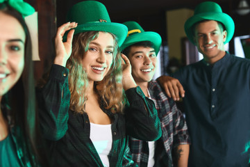 Young friends celebrating St. Patrick's Day in pub Wall mural