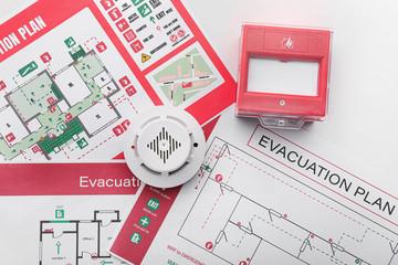 Obraz Evacuation plans, smoke detector and manual call point on white background - fototapety do salonu