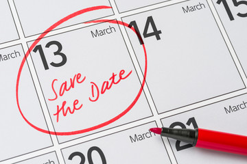 Save the Date written on a calendar - March 13