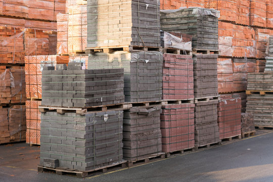 pallets with bricks in the building store. Racks with brick. Masonry, stonework. Several pallets with concrete brick stacked on top of each other in depot. new bricks on pallets
