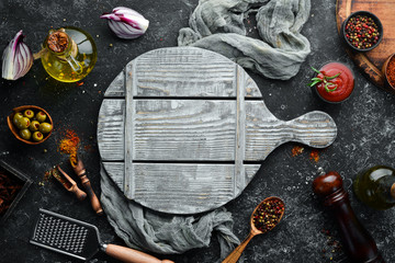 Wall Mural - Food background. Spices, herbs and kitchen tools. Top view. free space for your text. Rustic style.
