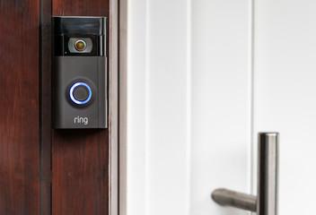 Brilon, North Rhine Westphalia / Germany - December 20th 2019:A modern surveillance camera is installed on a front door.