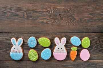 Colorful easter ginger cookies on table.