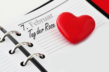 Calendar with heart and German: Rose Day in February