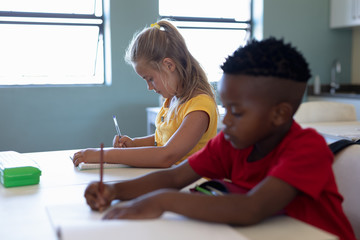 Schoolchildren writing during a lesson in an elementary school classroom