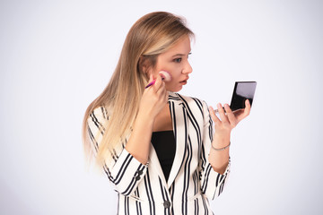 Portrait of Young Business Woman Doing Makeup