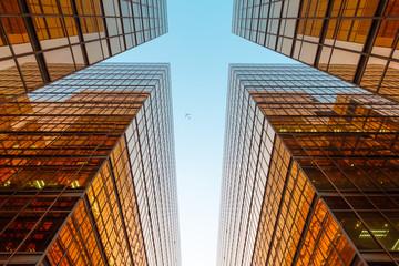 golden glass facade of modern  office building and blue sky