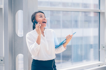 African businesswoman talking on phone