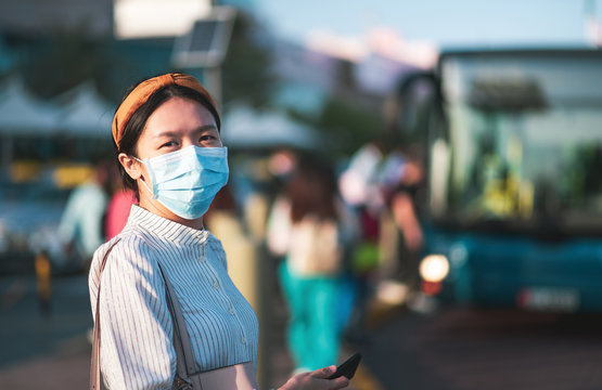 Portrait of woman wearing surgical face mask at bus station