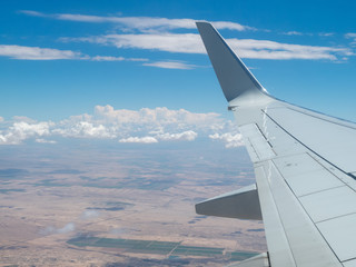 View of airborne passenger airliner flying over some unpopulated plains