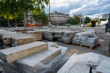 Pile of marble slabs in park area for construction in city