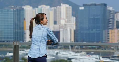 Wall Mural - Woman look at the city view in Hong Kong