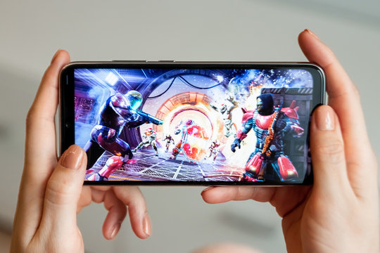 Brest, Belarus, January 31, 2020: Mobile game Shadow Gun Legends on the Xiaomi Redmi Note 8 smartphone screen close-up. A person is playing a game on a smartphone.