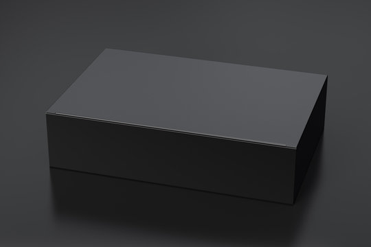 Blank black wide flat box with closed hinged flap lid on black background. Clipping path around box mock up. 3d illustration
