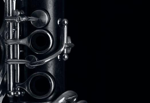clarinet body on black background