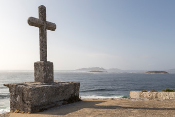 cruziro, one of the symbols of Galicia, in the background the Cies Islands, Galicia, Spain