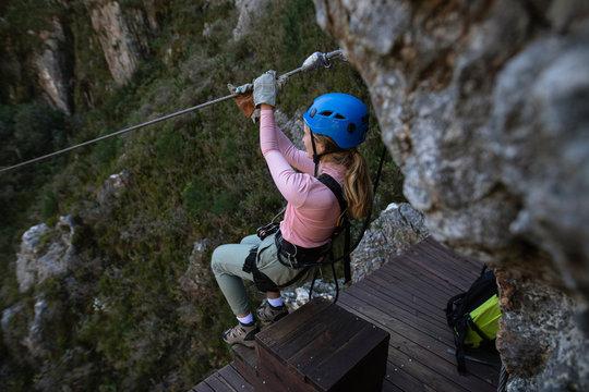 Caucasian woman doing zip line