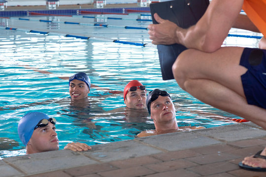 Coach and swimmers at the pool