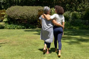 Two women walking in the garden