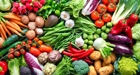 Foto op Canvas Keuken Food background with assortment of fresh organic vegetables