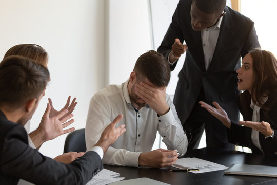 Frustrated employee feels stressed suffers from hostile coworkers