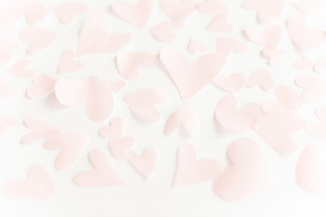 Cute pink pastel hearts on white paper  background. Happy valentines day. Pink paper heart cutouts on white backdrop, gentle image, greeting card. Valentine pattern